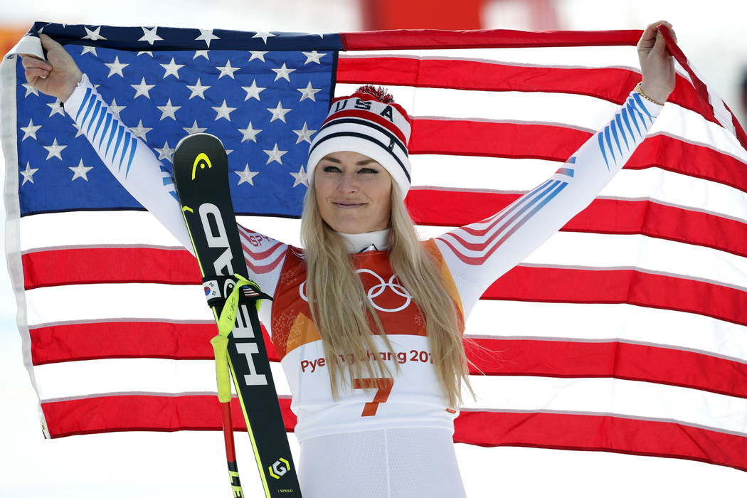 Bronze medal winner Lindsey Vonn, of the United States, celebrates during the flower ceremony for the women's downhill at the 2018 Winter Olympics in Jeongseon, South Korea.  (AP Photo/Christophe  ...