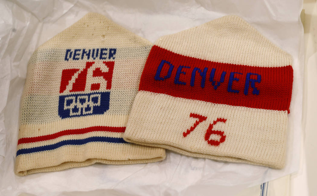 In this Feb. 1, 2018, photo, stocking hats used in Colorado's effort to secure an Olympic bid in 1976 are part of the memorabilia collection of the Denver Public Library in Denver. Over 40 years a ...
