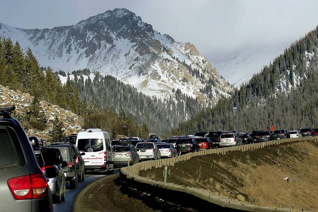In this Jan. 7, 2018, photo, traffic backs up on Interstate 70 in Colorado, a familiar scene on the main highway connecting Denver to the mountains The chairman of a committee exploring whether De ...