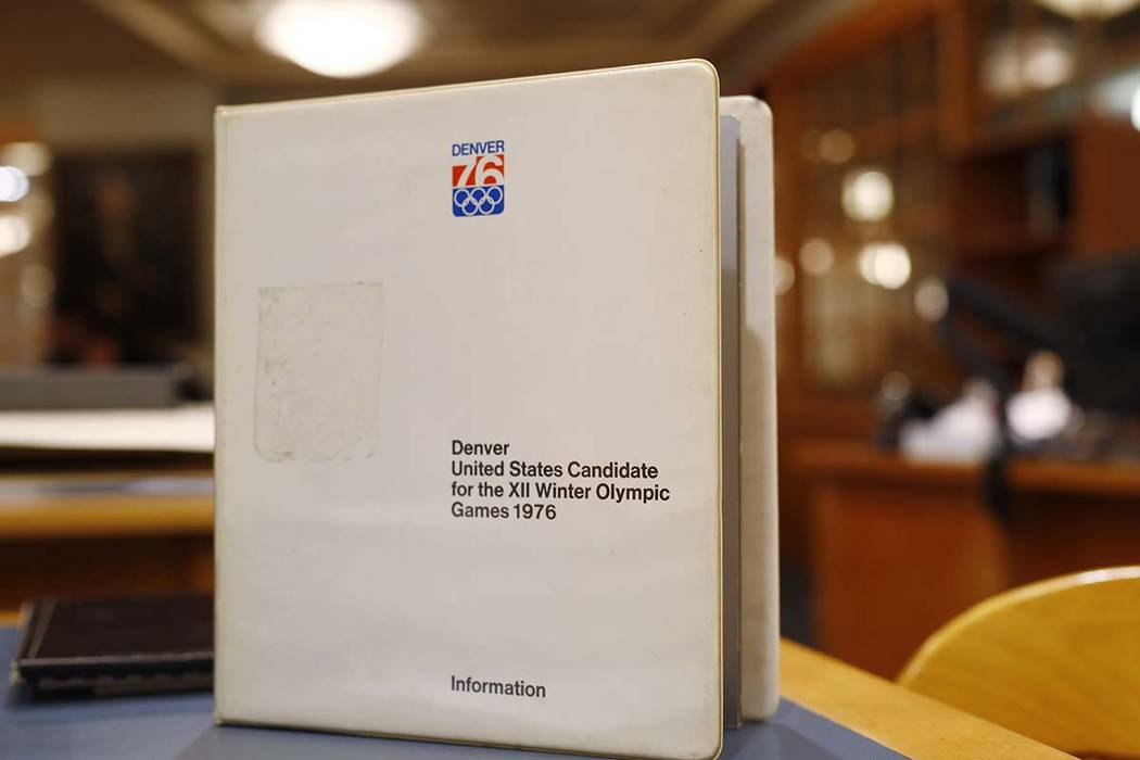In this Feb. 1, 2018, photo, a binder filled with information used in Colorado's effort to secure an Olympic bid in 1976 is part of the memorabilia collection of the Denver Public Library in Denve ...