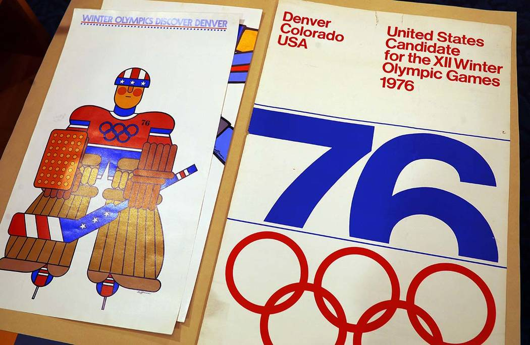 In this Feb. 1, 2018, photograph, one of the posters used in Colorado's effort to secure an Olympic bid in 1976 is part of the memorabilia collection of the Denver Public Library in Denver. Over 4 ...
