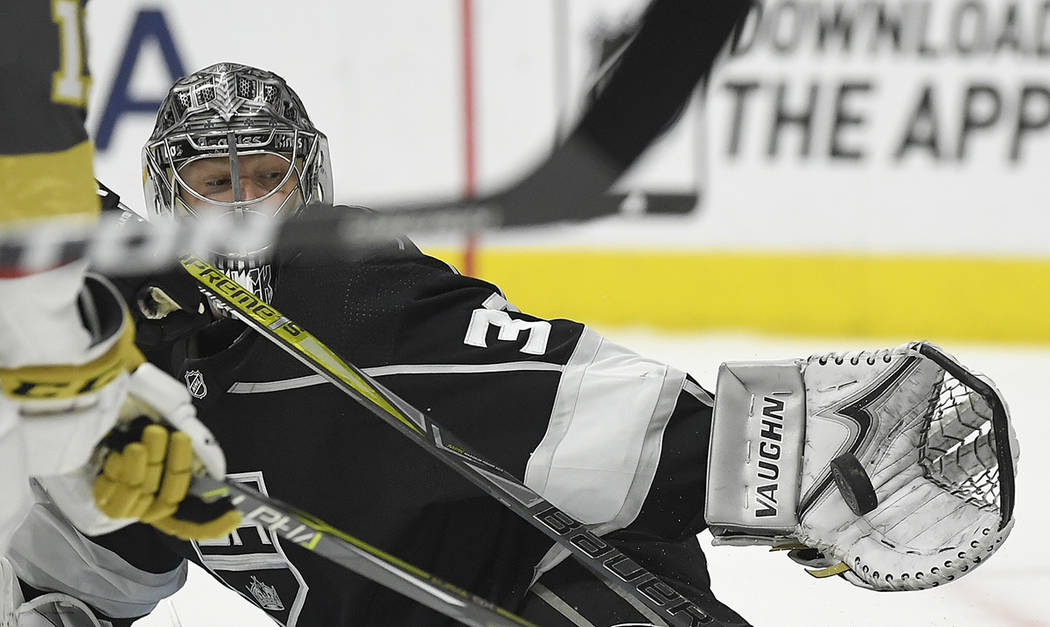 Los Angeles Kings goaltender Jonathan Quick makes a glove-save during the  first period of 9d74f9b81
