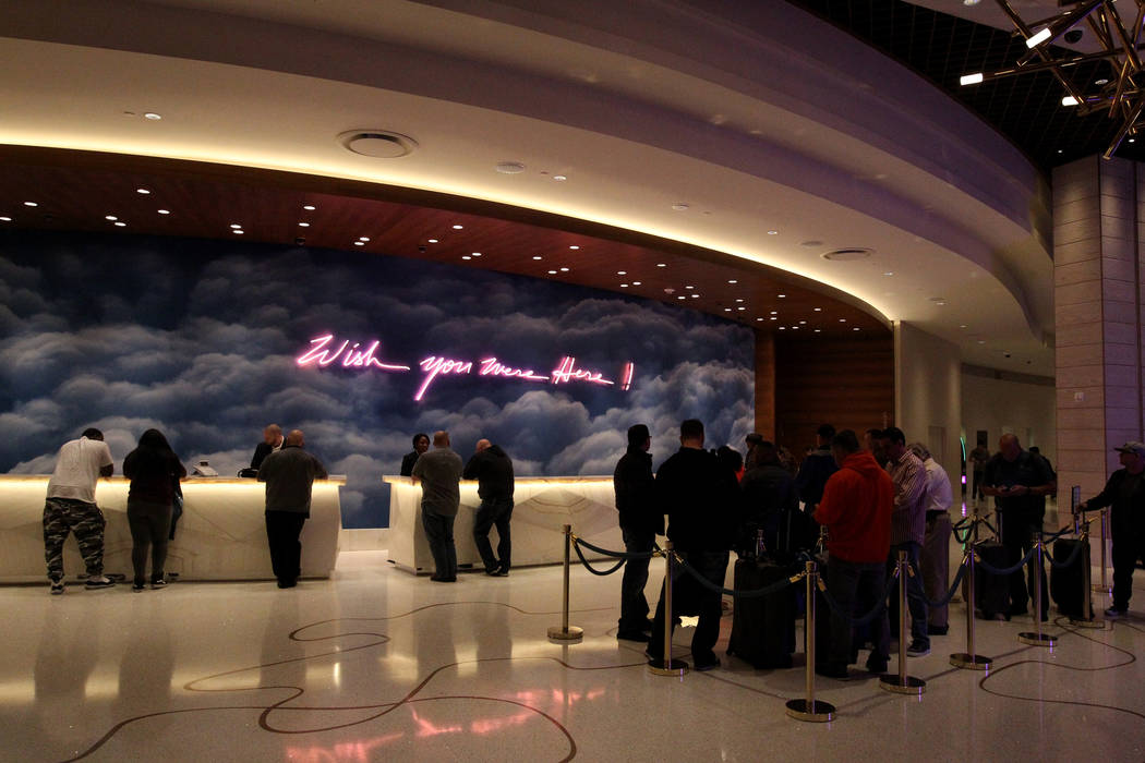 The recently-unveiled front desk at the Palms features an art collaboration between neon artist Olivia Steele and photographer Keegan Gibbs Tuesday, Feb. 27, 2018. The venues will be operated in p ...