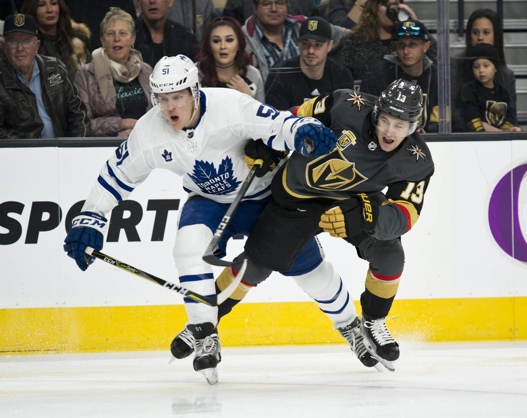 Vegas Golden Knights left wing Brendan Leipsic (13) struggles with Toronto Maple Leafs defenseman Jake Gardiner (51) during their game at T-Mobile Arena in Las Vegas on Sunday, December 31, 2017.  ...