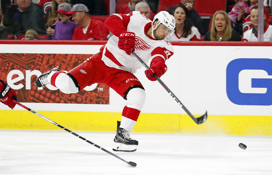 Detroit Red Wings' Tomas Tatar (21) shoots the puck against the Carolina Hurricanes during the first period of an NHL hockey game, Friday, Feb. 2, 2018, in Raleigh, N.C. (AP Photo/Karl B DeBlaker)