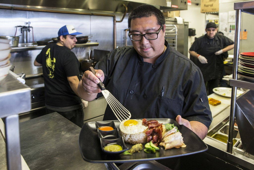 Flock & Fowl owner Chef Sheridan Su prepares Hainanese chicken rice with Mary's free range chicken, chicken schmaltz rice, organic fried egg, Chinese sausage, cucumbers,, pickled mustard, gree ...