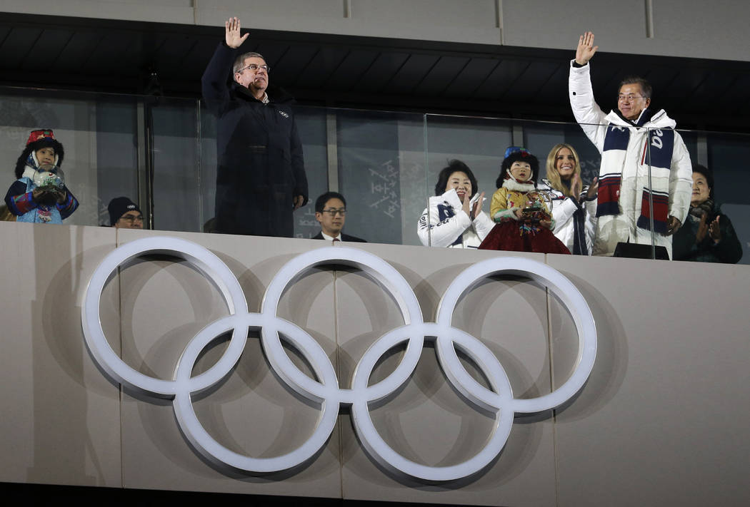 Thomas Bach, president of the International Olympic Committee, front left, South Korean President Moon Jae-in, front right, wave with Ivanka Trump, back right, U.S. President Donald Trump's daught ...