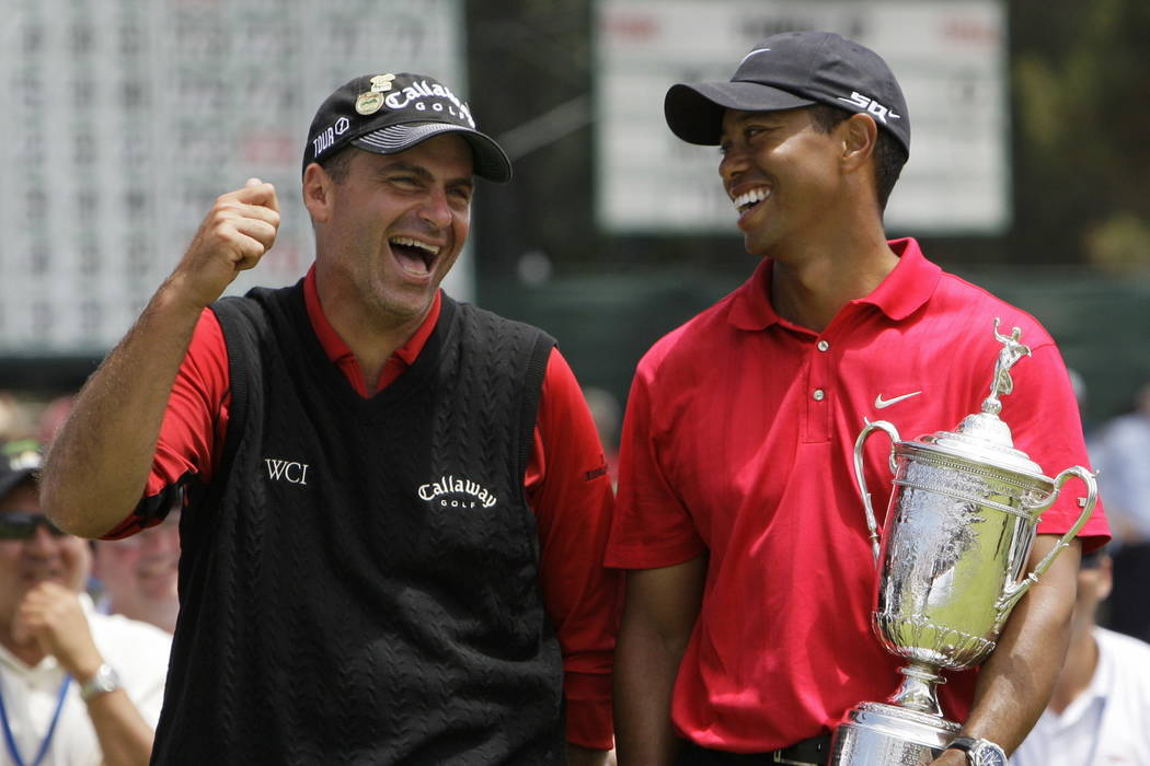 In this June 16, 2008, file photo, Rocco Mediate. left, jokes with Tiger Woods following Woods' U.S. Open championship victory after playing a sudden death hole following an 18-hole playoff round  ...