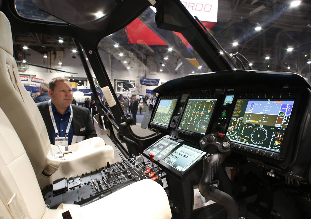 Tim Cornell checks out the full digital glass cockpit of the AW169, 10-seat helicopter developed and manufactured by the Leonardo's Helicopter Division, during the 2018 International Helicopter In ...