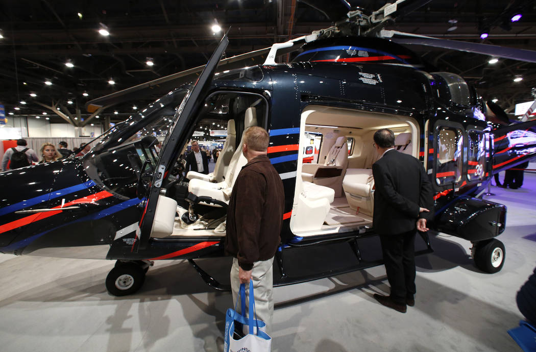 Jeff Marantette, left, and Rob Giguere check out the AW169, 10-seat helicopter developed and manufactured by the Leonardo's Helicopter Division, during the 2018 International Helicopter Industry E ...