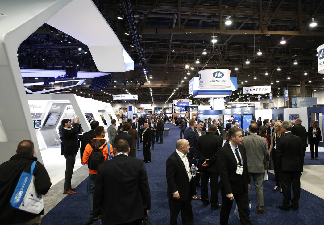Exhibitgoers attend the 2018 International Helicopter Industry Exhibition at the Las Vegas Convention Center on Tuesday, Feb. 27, 2018, in Las Vegas. (Bizuayehu Tesfaye/Las Vegas Review-Journal) @ ...