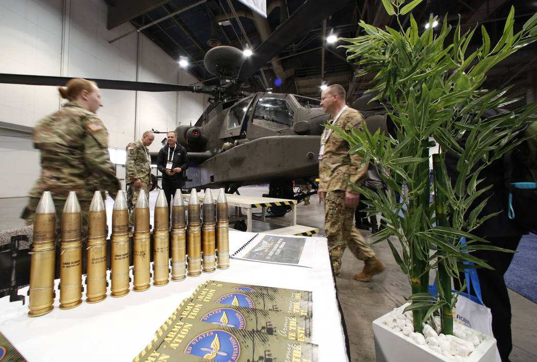 The U.S. Army helicopter and bullets are displayed during the 2018 International Helicopter Industry Exhibition at the Las Vegas Convention Center on Tuesday, Feb. 27, 2018, in Las Vegas. (Bizuaye ...