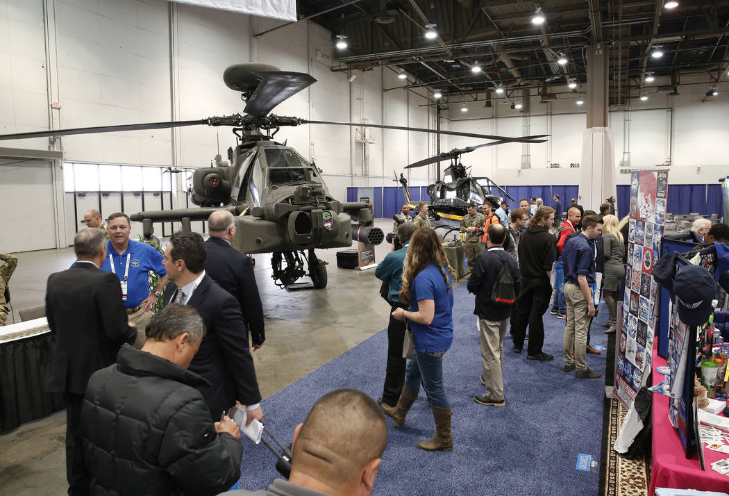 Exhibitgoers watch the U.S. Army helicopters during the 2018 International Helicopter Industry Exhibition at the Las Vegas Convention Center on Tuesday, Feb. 27, 2018, in Las Vegas. (Bizuayehu Tes ...