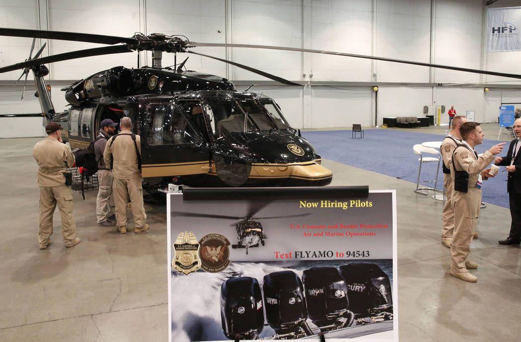 The U.S. Customs and Border Protection's helicopters is displayed during the 2018 International Helicopter Industry Exhibition at the Las Vegas Convention Center on Tuesday, Feb. 27, 2018, in Las  ...