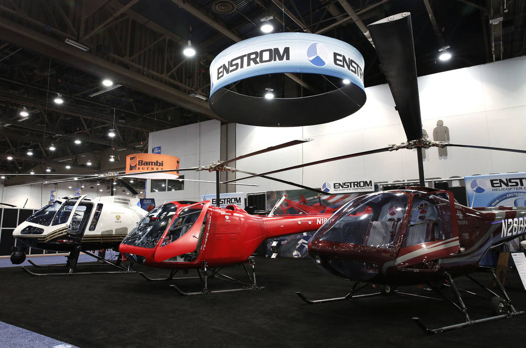 Enstrom 280FX, right, THI80, center, and 480B helicopters are displayed during the 2018 International Helicopter Industry Exhibition at the Las Vegas Convention Center on Tuesday, Feb. 27, 2018, i ...