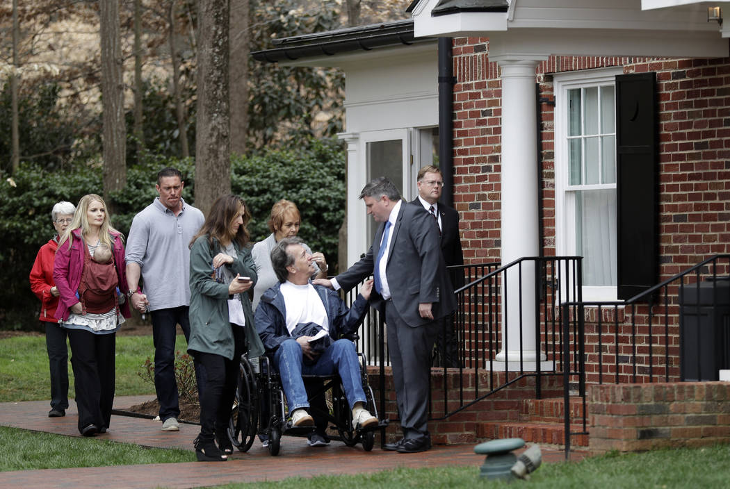Roy Graham, right, grandson of Billy Graham, greets people as they arrive to pay respects to Billy Graham during a public viewing at the Billy Graham Library in Charlotte, N.C., Monday, Feb. 26, 2 ...