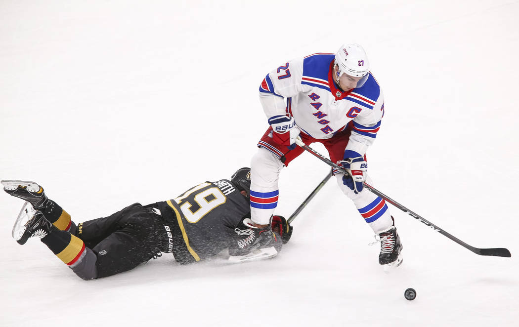 15874c683 ... York Rangers captain Ryan McDonagh. Vegas Golden Knights right wing  Reilly Smith (19) falls to the ice defending New