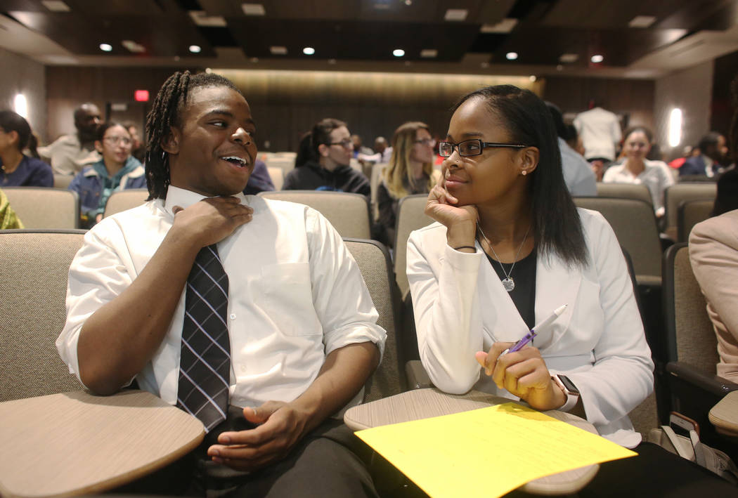 Aaron Miller, 17, talks to Shanya Espy, 18, about a personal story from his life that dealt with race either positive or negative during an activity for Dr. Howard Stevenson's lecture about racial ...