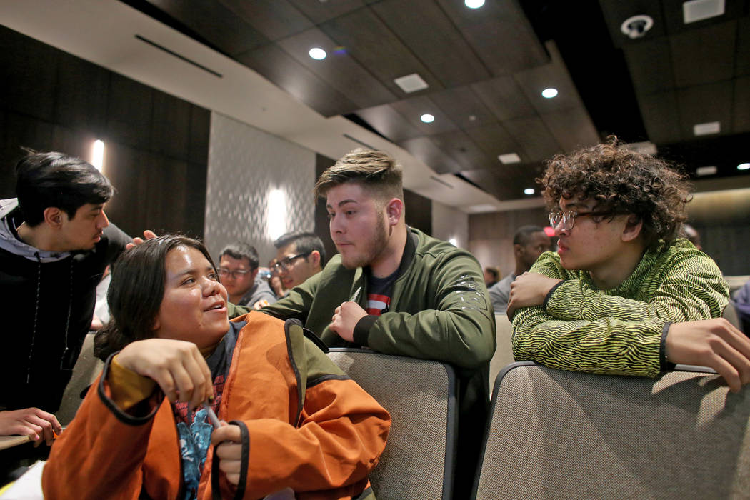 Gabriela Jimenez, from left, Alonso Contreras, and Joshua Valencia share personal stories about race during an activity for Dr. Howard Stevenson's lecture about racial literacy at the College of S ...