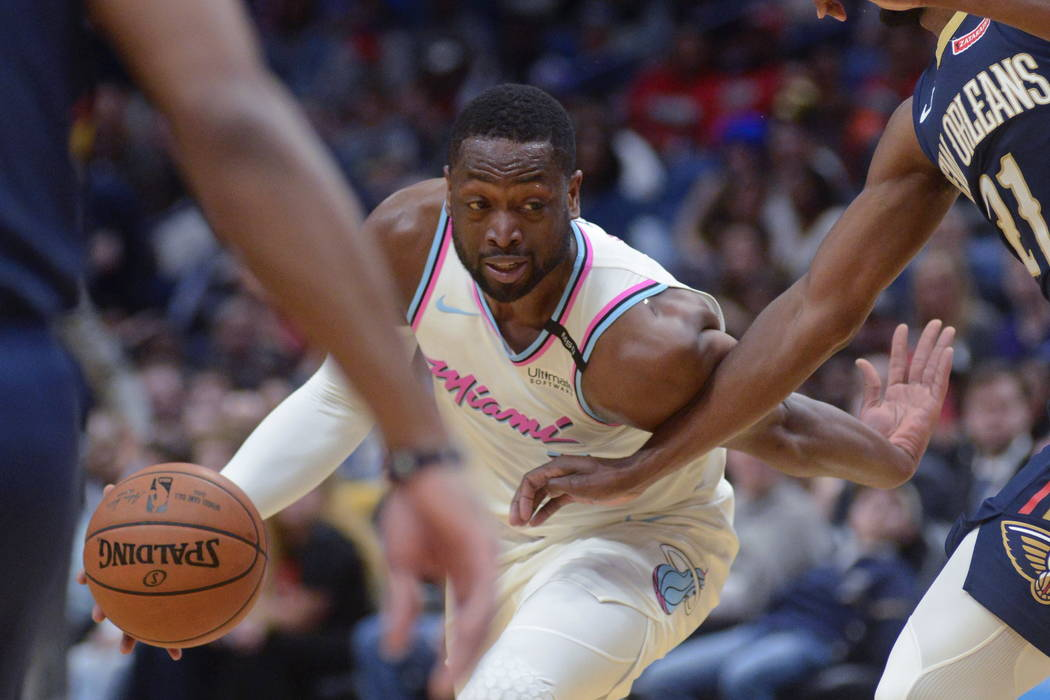 a328c68100f Miami Heat guard Dwayne Wade drives to the basket against New Orleans  Pelicans in the first