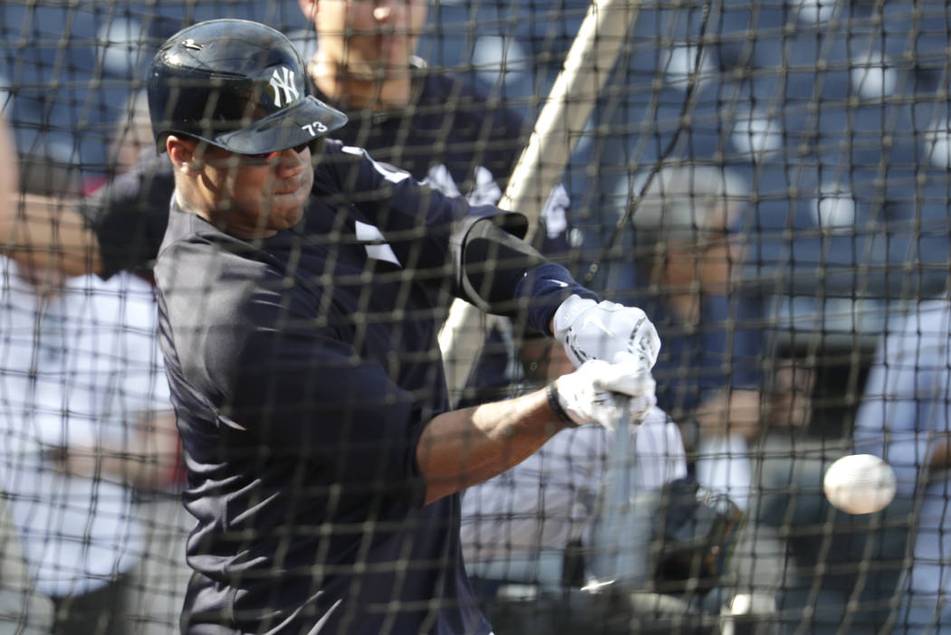 Seattle Seahawks quarterback Russell Wilson hits during batting practice before a baseball spring exhibition game against the Philadelphia Phillies, Monday, Feb. 26, 2018, in Tampa, Fla. (AP Photo ...