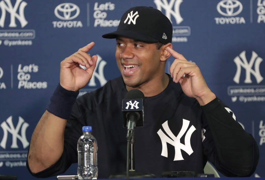 Seattle Seahawks NFL football team quarterback Russell Wilson speaks during a news conference at New York Yankees baseball spring training camp, Monday, Feb. 26, 2018, in Tampa, Fla. (AP Photo/Lyn ...