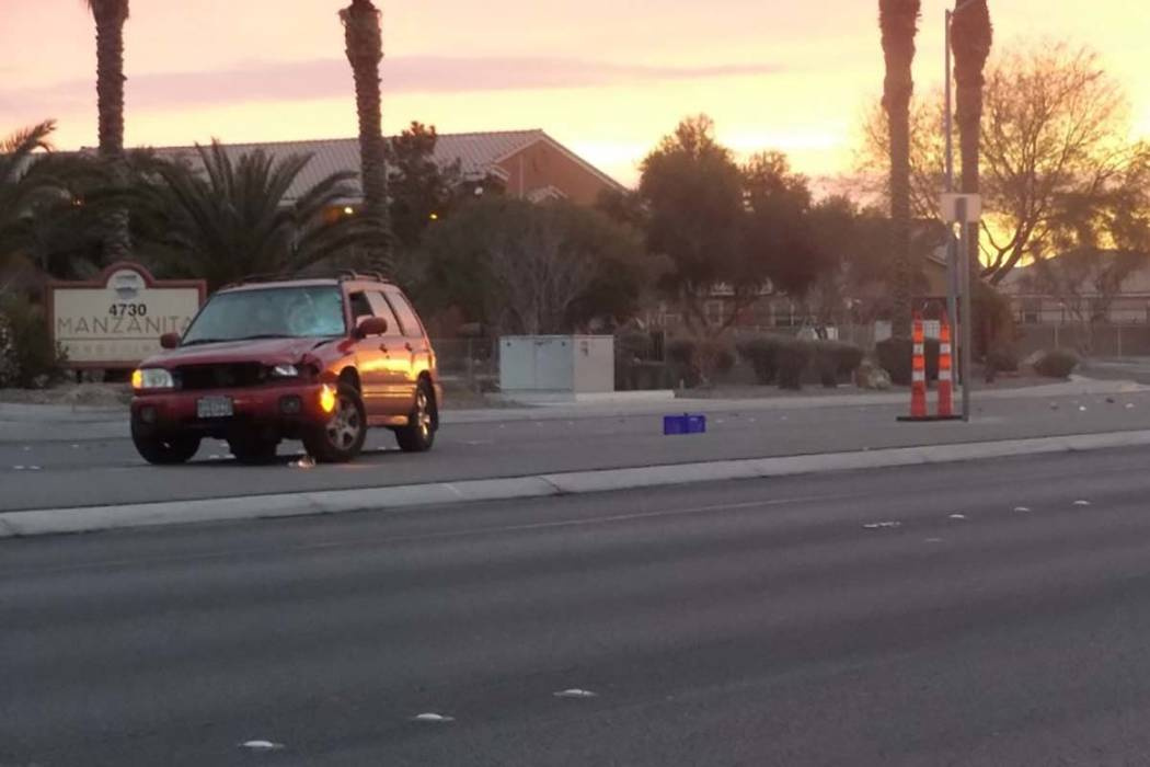 The driver of a red sports utility vehicle remained on the scene after a pedestrian was struck trying to cross Puebla Street at Craig Road on Tuesday morning. (Max Michor/Las Vegas Review-Journal)