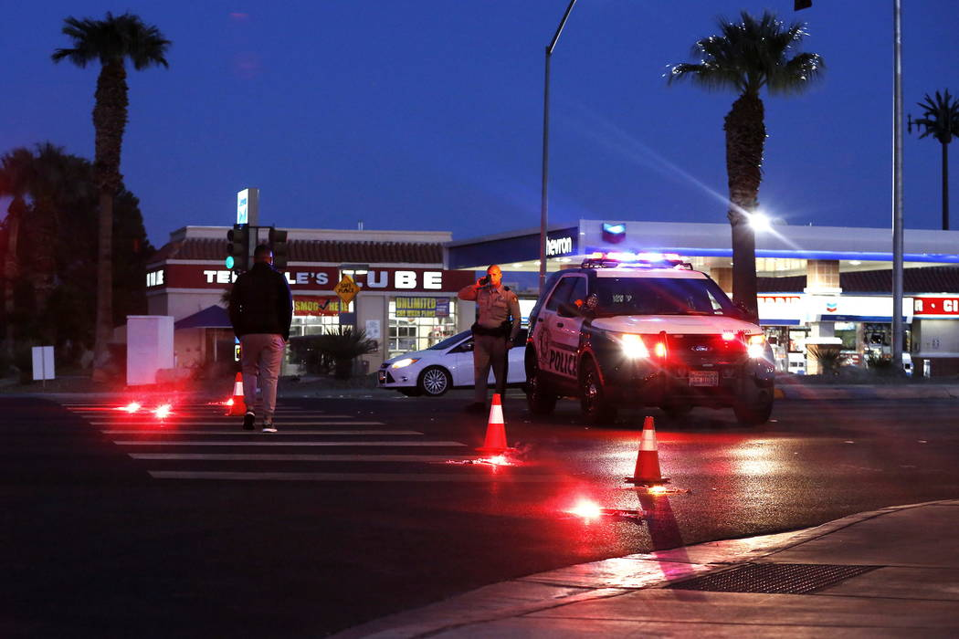 Las Vegas police officers investigate the scene of a two-vehicle crash near Rainbow Boulevard and Westcliff Drive in the western Las Vegas Valley on Sunday, Feb. 25, 2018. Two people were killed.  ...