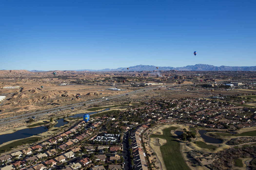 Balloons dot the sky over Mesquite during the seventh annual Mesquite Balloon Festival on Friday, Jan. 26, 2018.  Patrick Connolly Las Vegas Review-Journal @PConnPie