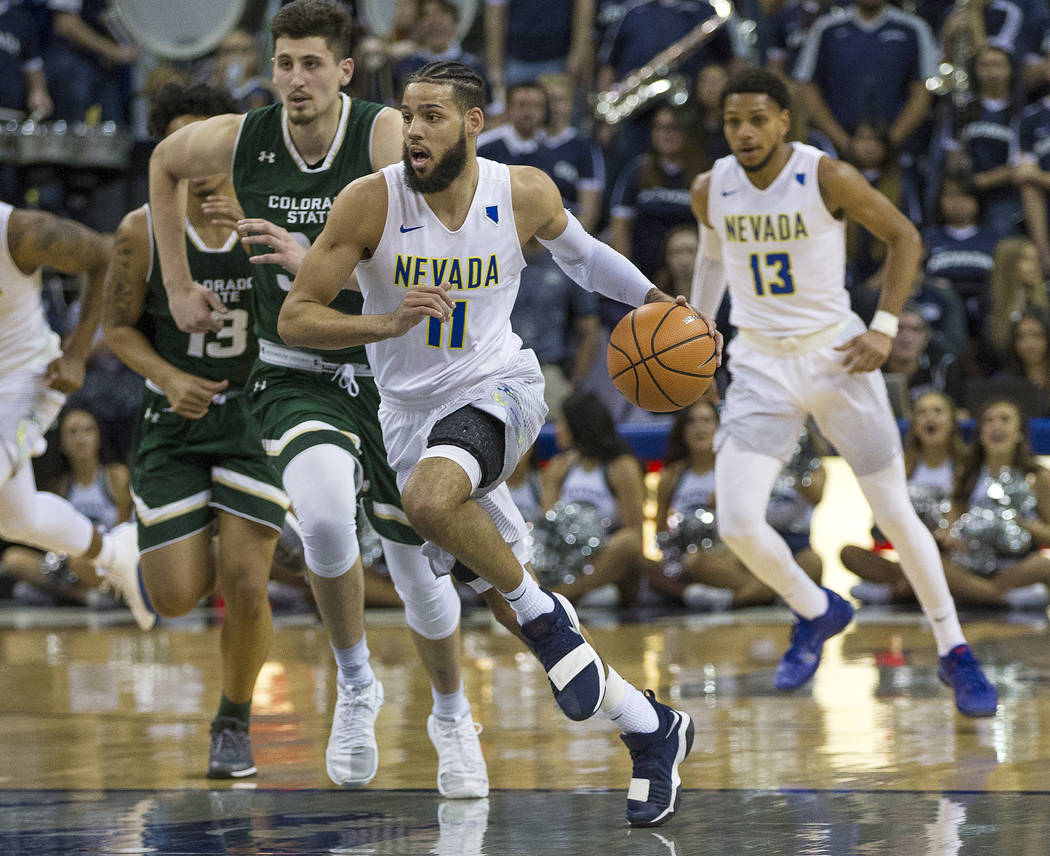 Nevada's Cody Martin on a fast break against Colorado State in the second half of an NCAA college basketball game in Reno, Nev., Sunday, Feb. 25, 2018. (AP Photo/Tom R. Smedes)
