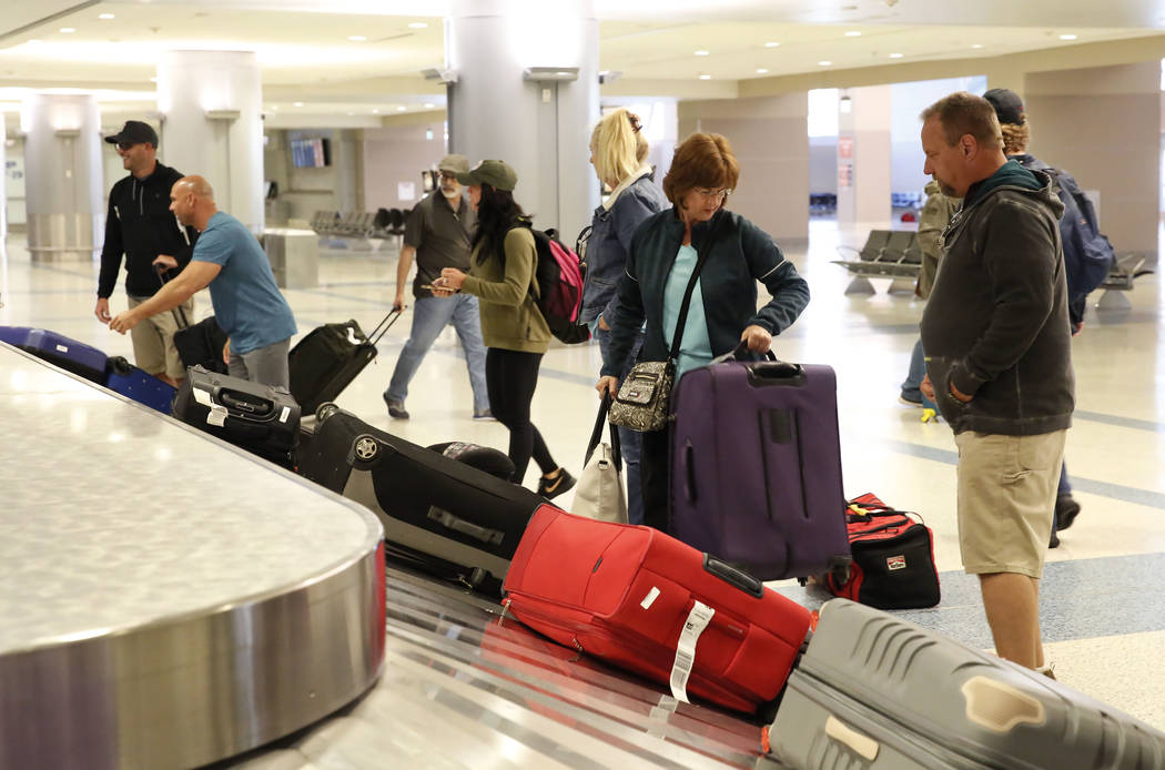 Arriving passengers wait for their luggage at the baggage claim area at Terminal-3 at McCarran International Airport on Wednesday, Feb. 28, 2018, in Las Vegas. (Bizuayehu Tesfaye/Las Vegas Review- ...