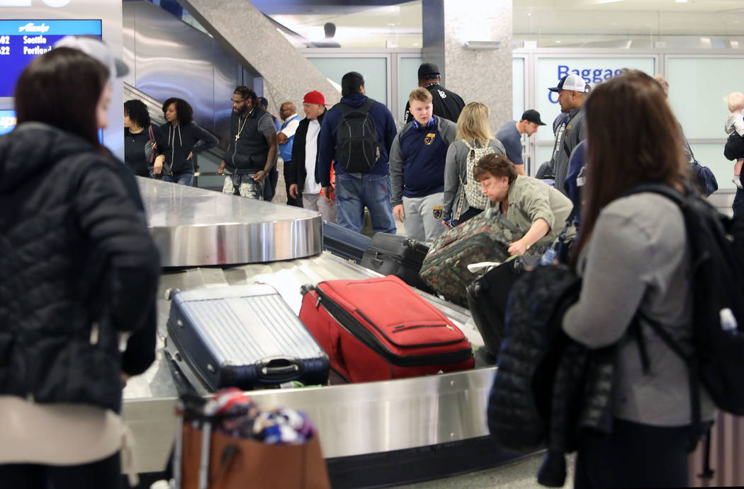 Arriving passengers wait for their luggage at the baggage claim area at Terminal-3 at McCarran International Airport on Wednesday, Feb. 28, 2018, in Las Vegas. Bizuayehu Tesfaye/Las Vegas Review-J ...