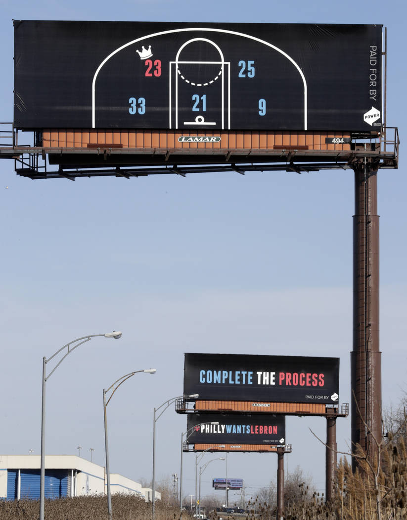 Three billboards trying to entice Cleveland Cavaliers' LeBron James to come to Philadelphia are shown near a highway, Tuesday, Feb. 27, 2018, in Cleveland. The three billboards were unveiled on Mo ...