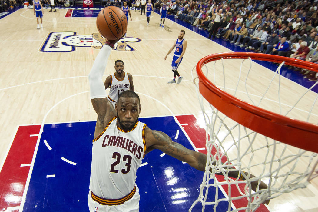 FILE - In this Nov. 5, 2016, file photo, Cleveland Cavaliers' LeBron James soars to the basket during the second half of an NBA basketball game against the Philadelphia 76ers in Philadelphia.  (AP ...