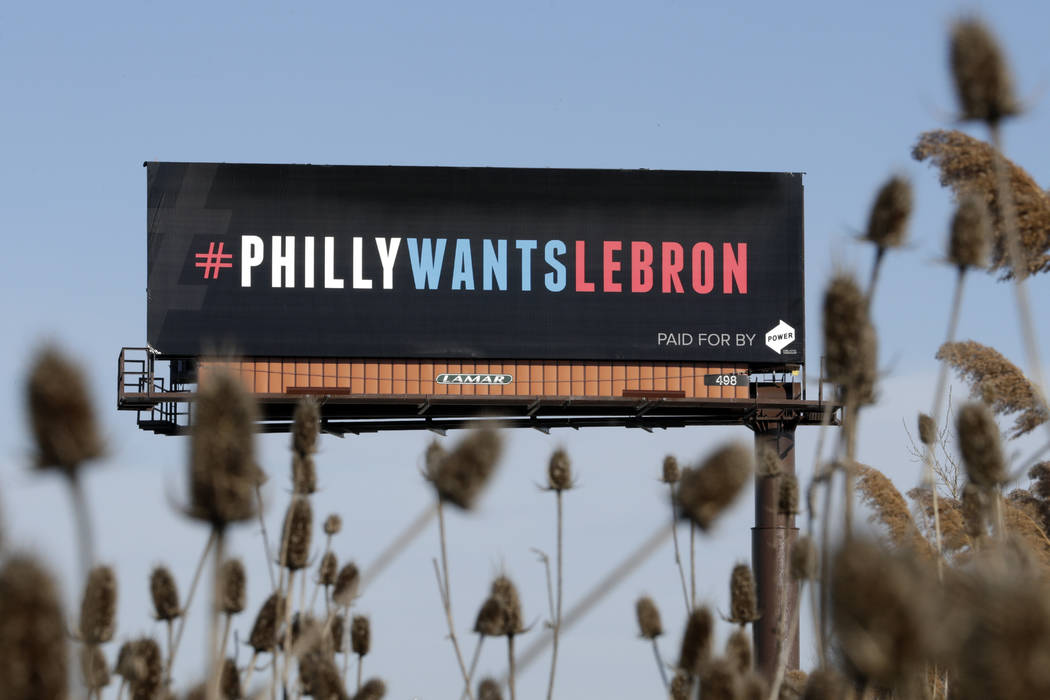 One of three billboards trying to entice Cleveland Cavaliers' LeBron James to come to Philadelphia are shown near a highway, Tuesday, Feb. 27, 2018, in Cleveland. The three billboards were unveile ...