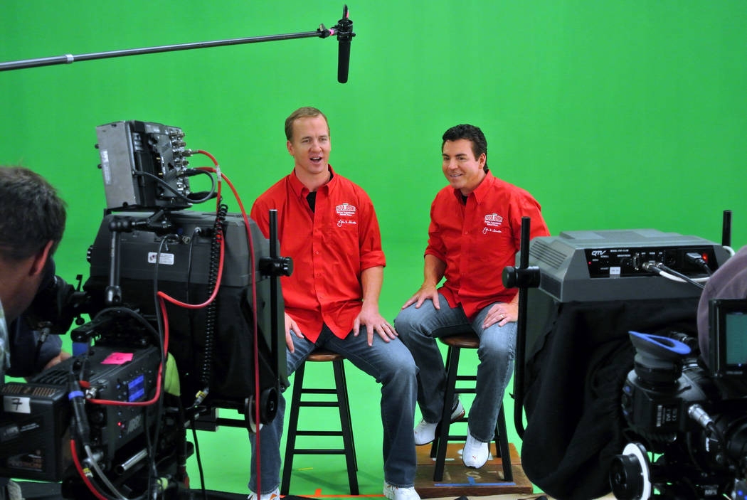 In this photo released by Papa John's on Friday, Oct. 26, 2012, Denver Broncos quarterback Peyton Manning, left, shoots a television spot with Papa John's Founder, Chairman and CEO John Schnatter, ...