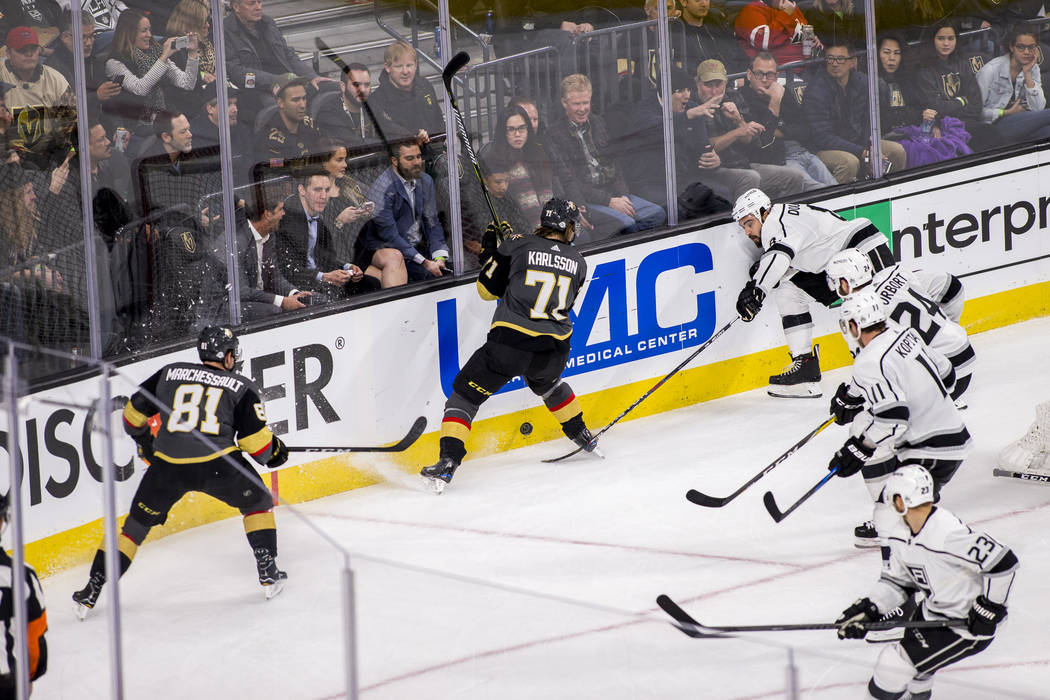Los Angeles Kings players try to swat the puck away from Vegas Golden Knights center William Karlsson (71) during the second period of an NHL hockey game at T-Mobile Arena on Tuesday, Feb. 27, 201 ...
