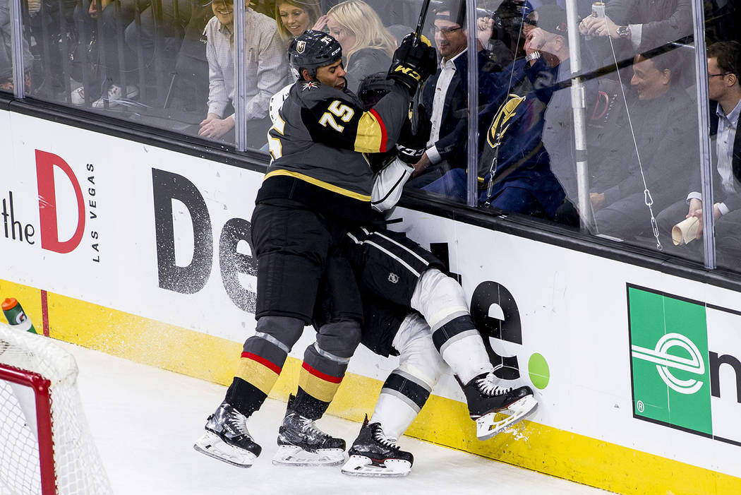 Vegas Golden Knights right wing Ryan Reaves (75) slams Los Angeles Kings defenseman Derek Forbort (24) against the glass during the third period of an NHL hockey game at T-Mobile Arena on Tuesday, ...