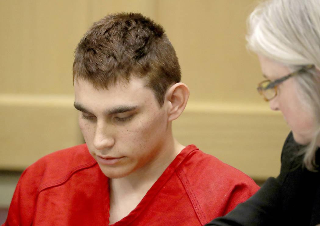 FILE - In this Feb. 19, 2018 file photo, Nikolas Cruz, accused of murdering 17 people in the Florida high school shooting, appears in court for a status hearing in Fort Lauderdale, Fla. Cruz repor ...
