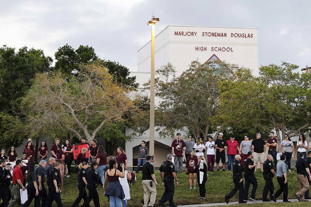 Police walk outside Marjory Stoneman Douglas High School in Parkland, Florida, Wednesday, Feb. 28, 2018. Students returned to class for the first time since 17 people were killed. (Terry Renna/AP)