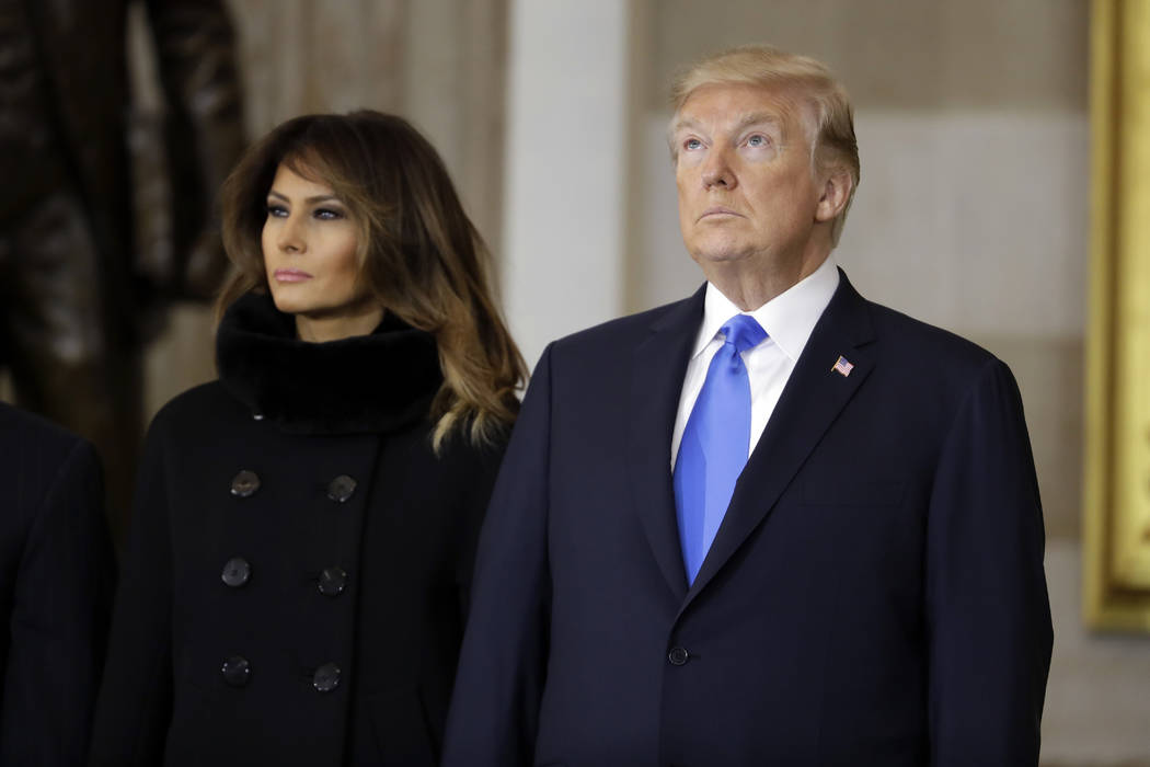 President Donald Trump and first lady Melania Trump, arrive to participate in a ceremony honoring Reverend Billy Graham in the Rotunda of the U.S. Capitol building, Wednesday, Feb. 28, in Washingt ...