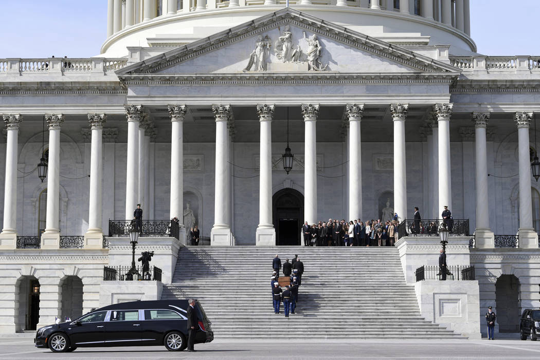 The casket of Rev. Billy Graham is carried up the steps of the U.S. Capitol in Washington, Wednesday, Feb. 28, 2018, where it will lie in honor in the Rotunda. It's a rare honor for a private citi ...