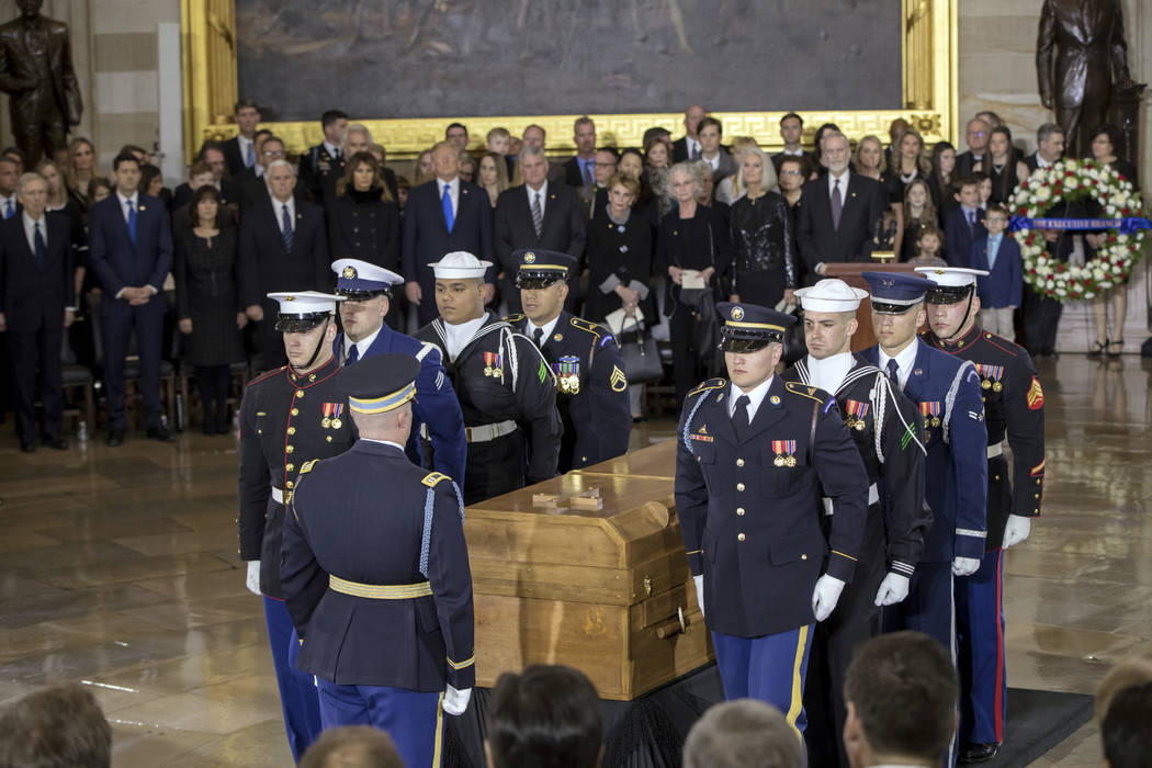 The body of Rev. Billy Graham is carried into the Capitol Rotunda where he will lie in honor as President Donald Trump, officials and dignitaries pay tribute to America's most famous evangelist, W ...