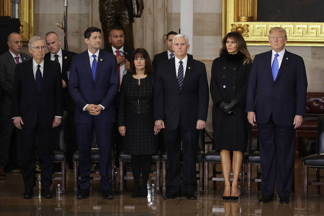 From right, President Donald Trump, first lady Melania Trump, Vice President Mike Pence, Karen Pence, House Speaker Paul Ryan of Wisconsin and Senate Majority Leader Mitch McConnell of Ky.,  parti ...