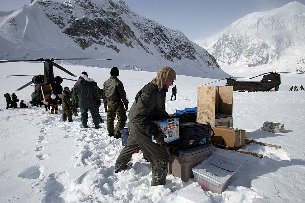 In this April 15, 2002, file photo, members of the U.S. Army's High Altitude Rescue Team from Fort Wainwright Army Base near Fairbanks, Alaska, unload supplies from the team's CH-47 Chinook helico ...