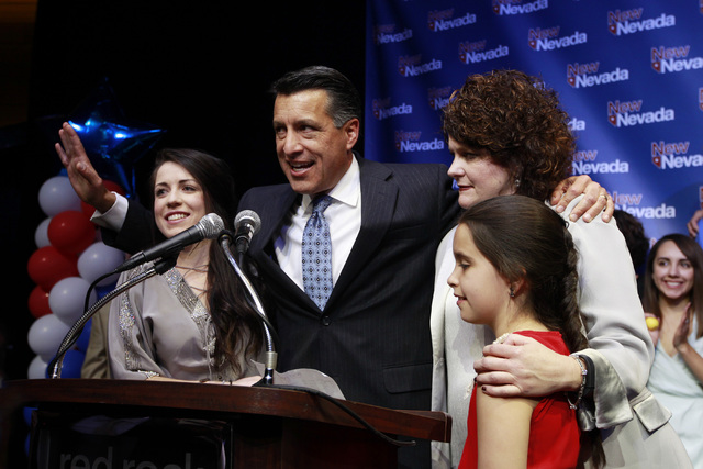 Nevada Gov. Brian Sandoval, his daughters Madeline, left, Marisa and wife Kathleen appear during the Nevada Republican Party election night party on Nov. 4, 2014 at Red Rock Resort. The Sandovals  ...