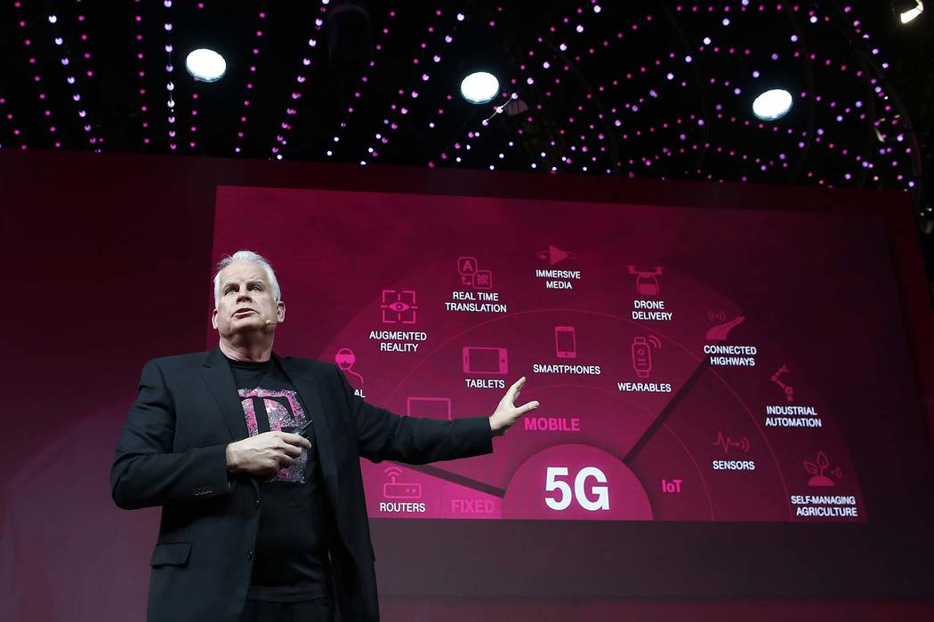 Chief Technology Officer Neville Ray details T-Mobile's plans to build a nationwide 5G network in the U.S. at Mobile World Congress on Tuesday, Feb. 27, 2018, in Barcelona, Spain. The Un-carrier i ...