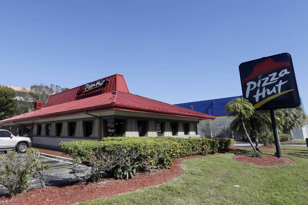 A Pizza Hut in Miami, Jan. 24, 2017. The NFL announced a multiyear marketing deal with Pizza Hut on Wednesday, Feb. 28, 2018, one day after the league and Papa John's said that they mutually agree ...