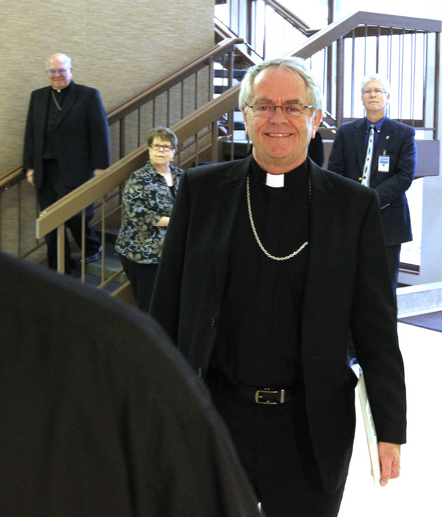 Bishop George Leo Thomas of the Diocese of Helena walks to a news conference at the Diocese of Las Vegas Wednesday, Feb. 28, 2018, where he was introduced as the new bishop of the Roman Catholic D ...
