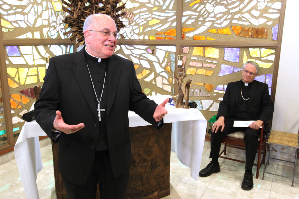Diocese of Las Vegas retiring Bishop Joseph A. Pepe, left, introduces Bishop George Leo Thomas of the Diocese of Helena, right, at a news conference in the Holy Angels Chapel at the Diocese of Las ...